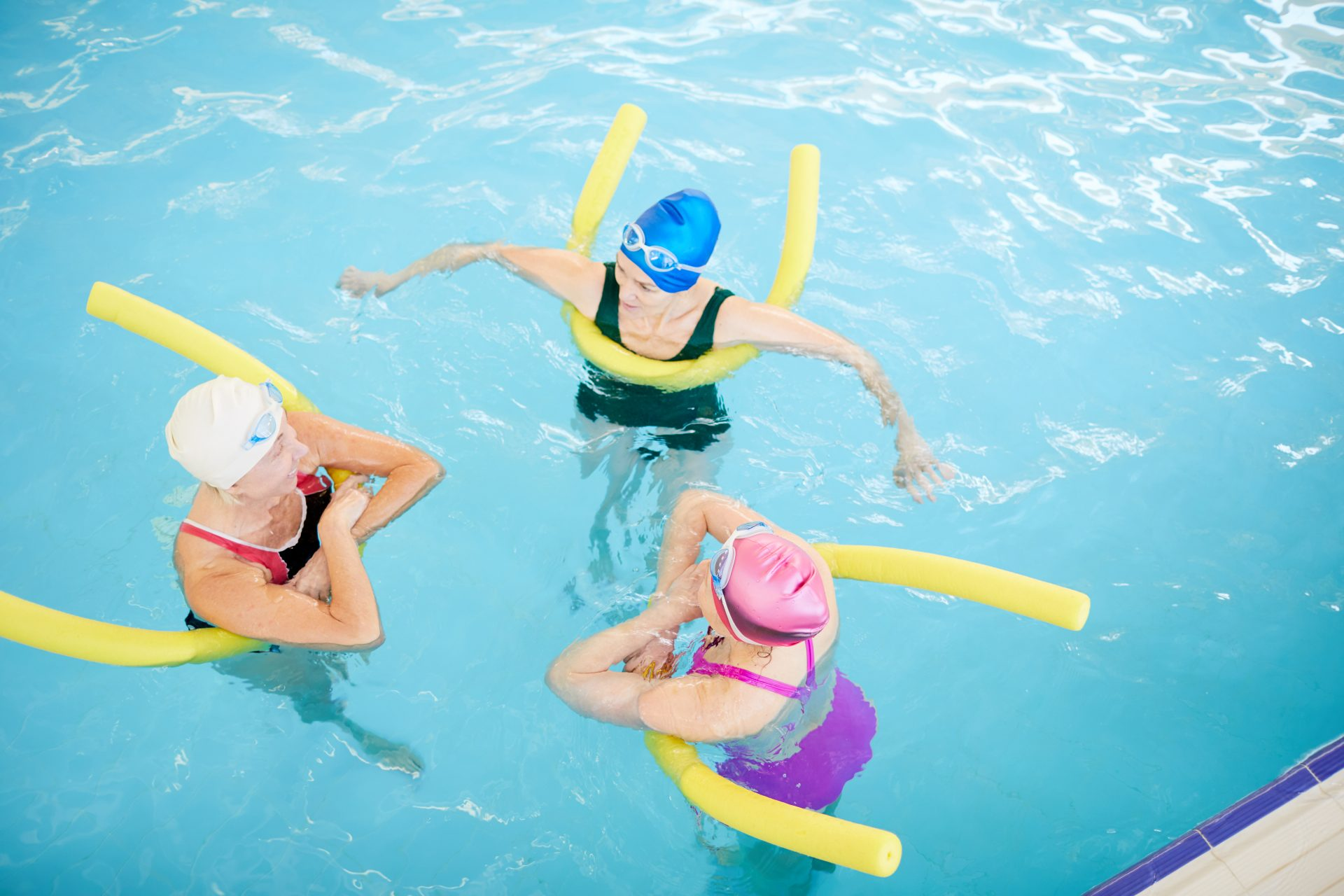 three women in the pool - Aquatic Therapy in Chase MD - Comprehensive Spine & Sports Center