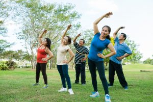 Seniors stretching outside - Chiropractor in Carney MD- Comprehensive Spine and Sports Center
